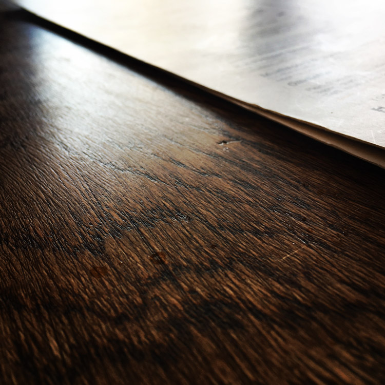 Abstract public domain image of a shiny wood surface